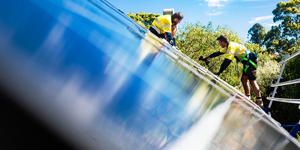 Installing solar panels on a roof in Canterbury