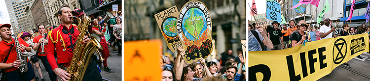 Colourful, vibrant costumes and signs at the climate march